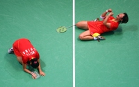 BEIJING- AUGUST 15: Yili Wei and Yawen Zhang of China react to their straight sets victory over the team of Miyuki Maeda and Satoko Suetsuna of Japan in the Women's Badminton Bronze Medal Match during the Beijing Summer Olympic Games on August 15, 2008 in Beijing, China. (Photo by Donald Miralle)