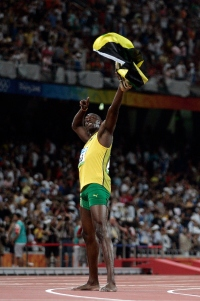 BEIJING- AUGUST 16: Blot of Jamaica wins the 100 meter final during day 8 of the Beijing 2008 Olympic Games at the National Stadium on August 16, 2008 in Beijing, China.(Photo by Donald Miralle)