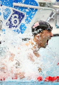 BEIJING - AUGUST 16: Michael Phelps of the United States celebrates victory in the Men's 100m Butterfly Final held at the National Aquatics Centre during Day 8 of the Beijing 2008 Olympic Games on August 16, 2008 in Beijing, China. By winning gold in the Men's 100m Butterfly Phelps tied Mark Spitz's record of winning seven gold medals in a single Olympic Games. (Photo by Donald Miralle/Newsweek)