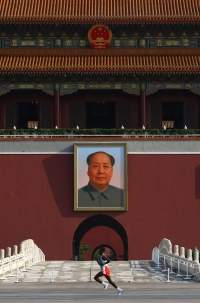 BEIJING - AUGUST 24: Athletes compete in the Men's Marathon as they run past Chairman Mao's portrait at Gate of Heavenly Peace, Entrance to the Forbidden City in Tiananmen Square on Day 16 of the Beijing 2008 Olympic Games on August 24, 2008 in Beijing, China. (Photo by Donald Miralle)