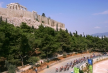 ATHENS - AUGUST 15: A general view of the competitors in the women's cycling road race passing the temple of the Parthenon a top the Acropolis on August 15, 2004 during the Athens 2004 Summer Olympic Games at the City Centre Cycling Road Race Course in Athens, Greece. (Photo by Donald Miralle/Getty Images)