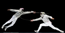 ATHENS - AUGUST 19: Keith Smart (L) of the USA competes Alexey Yakimenko of Russia in the men's fencing team sabre bronze medal match on August 19, 2004 during the Athens 2004 Summer Olympic Games at Helliniko Olympic Complex Fencing Hall in Athens, Greece. (Photo by Donald Miralle/Getty Images)