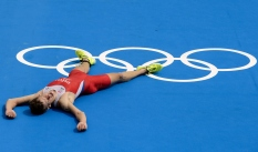LONDON, ENGLAND - AUGUST 7: Richard Varga of Slovakia collapses at the finish line during the Men's Triathlon Final, Day 12 of the London 2012 Olympic Games on August 7, 2012 at Hyde Park in London, England. (Photo by Donald Miralle) ***PICTURE OF THE DAY***