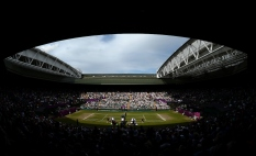 LONDON, ENGLAND - AUGUST 4: A general view of Serena Williams of the USA plays against Maria Sharapova of Russia during the Women's Tennis Final, Day 8 of the London 2012 Olympic Games on August 4, 2012 at Wimbledon Tennis Club in London, England. (Photo by Donald Miralle)