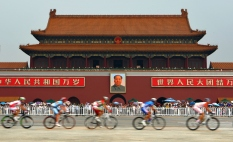 BEIJING- AUGUST 9: Competitors bike past Tiananmen Square during the Men's Cycling Road Race during the Beijing Summer Olympic Games on August 8, 2008 in Beijing, China. (Photo by Donald Miralle)